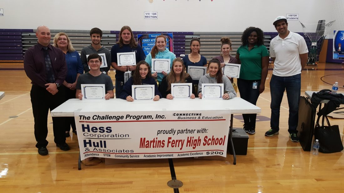 Photo provided THE CHALLENGE Program kicked off recently at Martins Ferry High School. Standing, from left, are Jim Mamone (principal), Darlene Kolanski (Hull & Associates), Cameron Tickerhoof (STEM), Jason Husvar (Attendance), Amanda Jacob (Academic Excellence), Jamie Fogle (Community Service), McKayla Martin (Academic Improvement), Suzette Law (Hess Corporation) and Alvin Kapil (Hess Corporation)