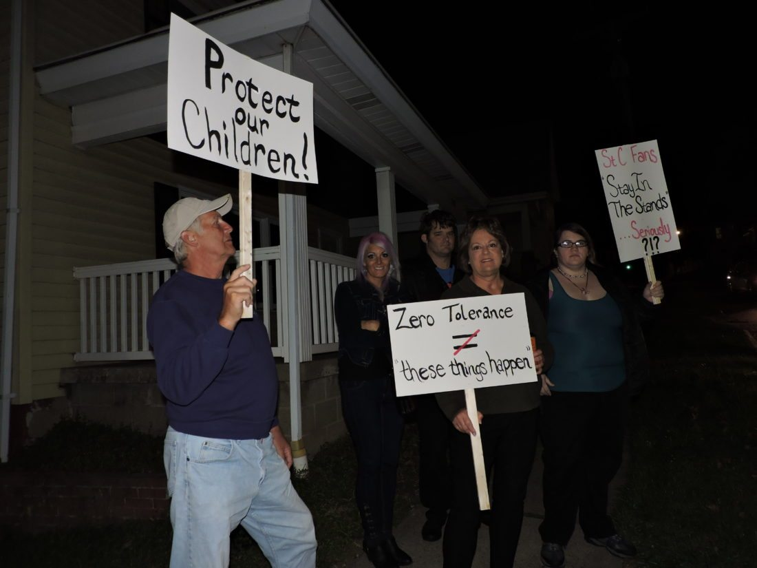 T-L Photo/SHELLEY HANSON PROTESTeRS HOLD signs near St. Clairsville High School on Monday morning.