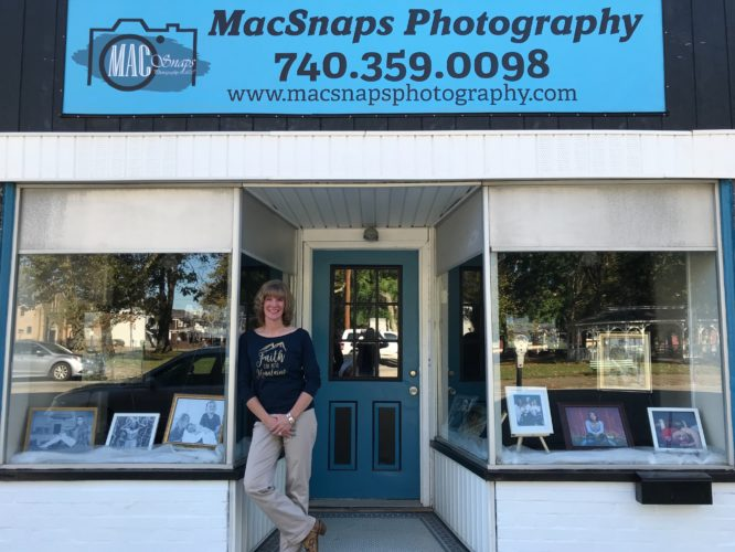 Photo Provided SHERI McANINCH, owner of MacSnaps Photography, stands in front of her new studio at 318 34th St. in Bellaire.
