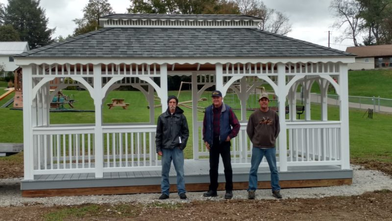 Officials from the village of Mount Pleasant stand in front of a new gazebo in a village park. The gazebo was installed by Smith's Sawdust Studio, a local business that specializes in custom sheds, barns, gazebos and more; the village reached out to owner Terry Smith for the work so as to utilize a local business.