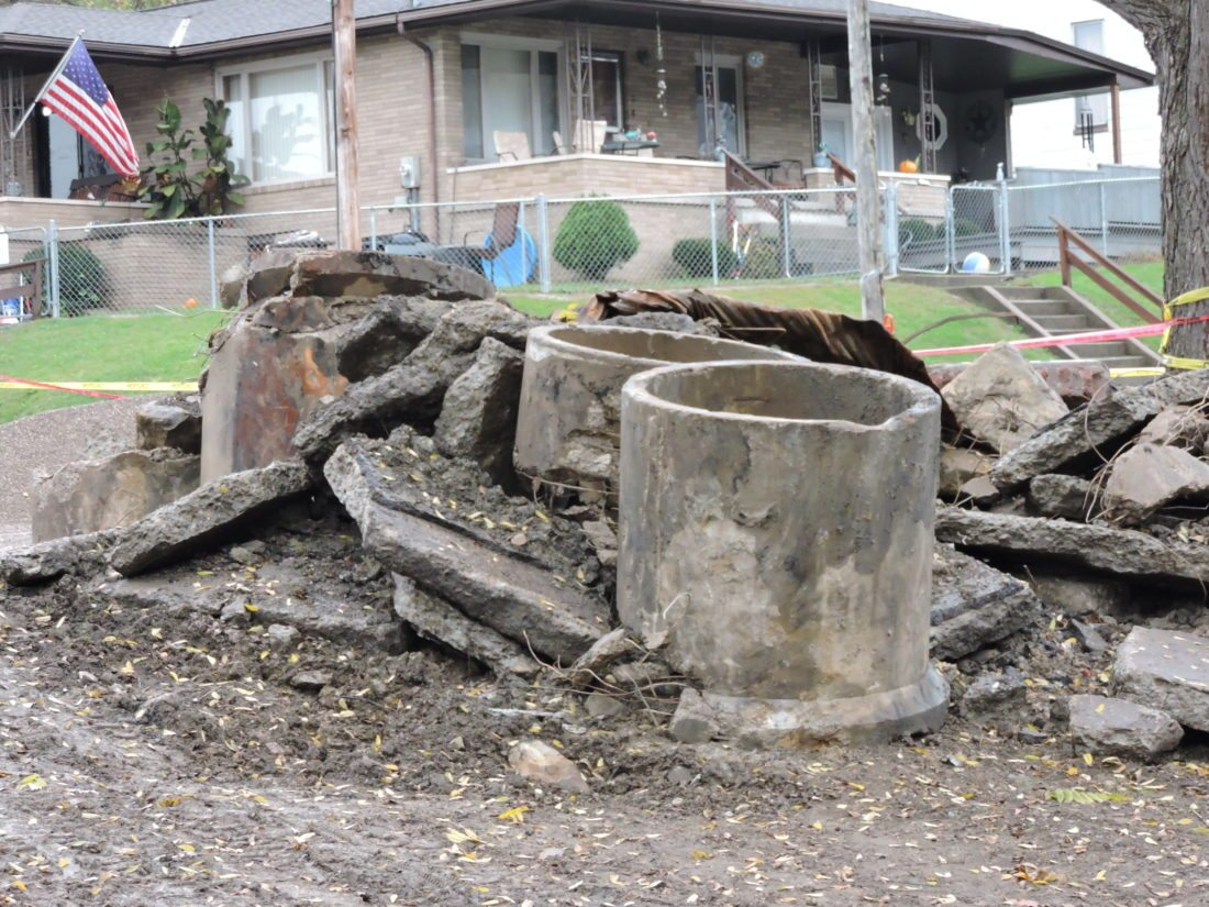 T-L Photos/SHELLEY HANSON REMNANTS OF the old stormwater drain is seen in West Bellaire.