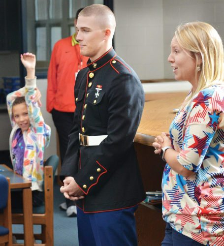 Photos by Scott McCloskey Neffs native Tyler West speaks to the fourth grade class at Bellaire Elementary as teacher Marci Quirk stands at his side.