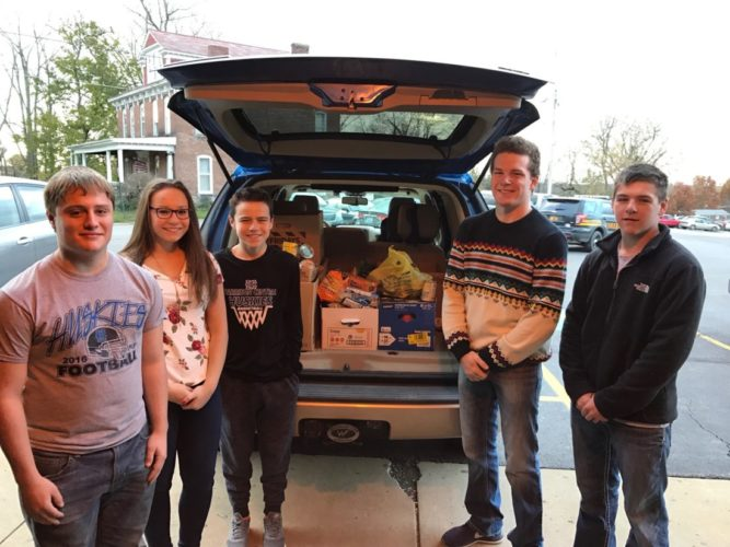 HARRISON CENTRAL Student Council members recently their held annual Thanksgiving canned food drive. They donated 464 items to the local food pantry. Some of the students who helped pack everything to be donated and taken to the food pantry include, from left, Jacob Shoup, Maria Roush, Jacob Mattern, Bailey Eberhart and Hayden Shaw.    Photo Provided