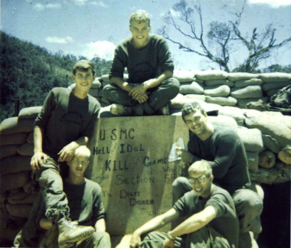 """Photo provided MARTINS FERRY resident Terry Wildman poses with his friends and members of the """"Dirty Dozen"""" in Vietnam in 1969. Clockwise, from left, are Rich Marlow (deceased), Randy Terkla (deceased), Jack Higgins, Wildman and Tim Ryan. Wildman was about 20 years old at the time."""
