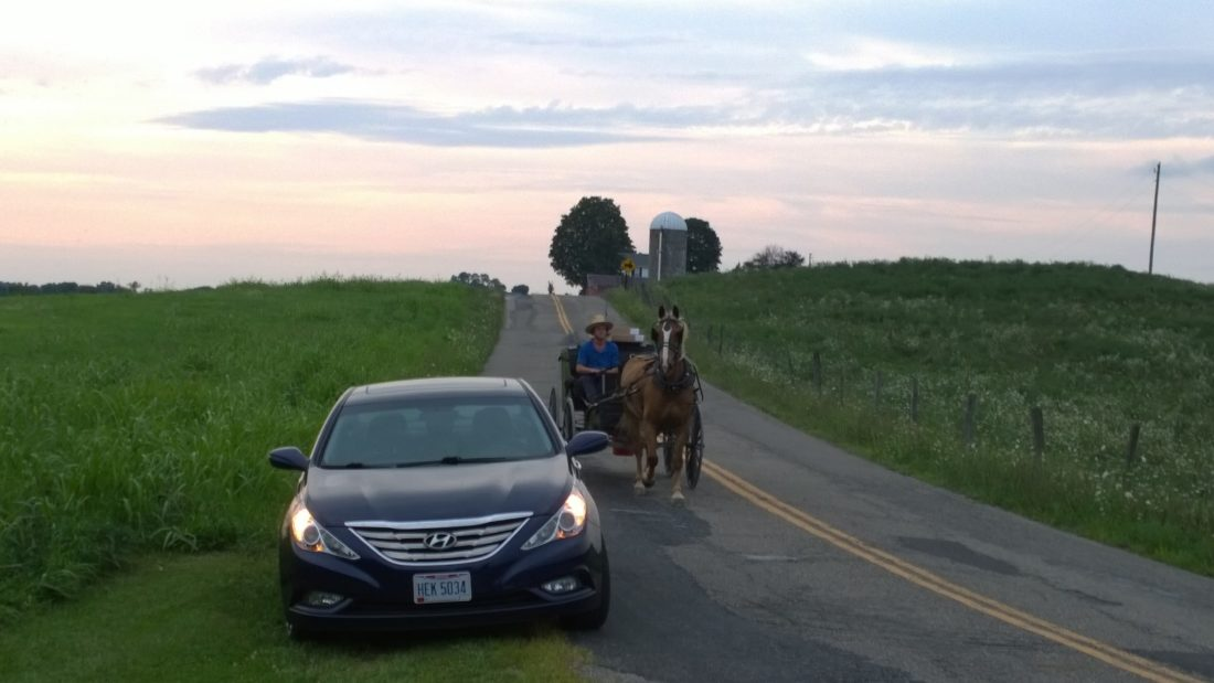 Amish buggies often are among the vehicles traveling local roadways, especially in more rural areas. Here, a buggy travels along Sandy Ridge Road outside Barnesville, near the scene of a crash involving another buggy.      T-L Photo/JENNIFER COMPSTON-STROUGH
