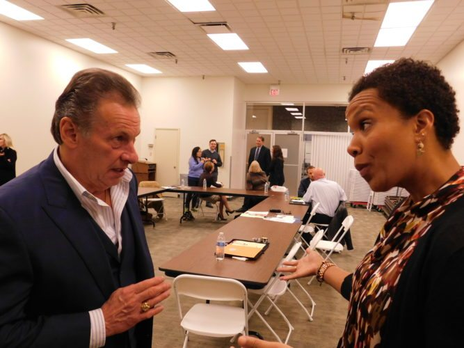 T-L Photo/ROBERT A. DEFRANK Alicia Freeman, executive director of A Special Wish Foundation, discusses issues with Belmont County Common Pleas Judge Frank Fregiato, a member of the advisory board.