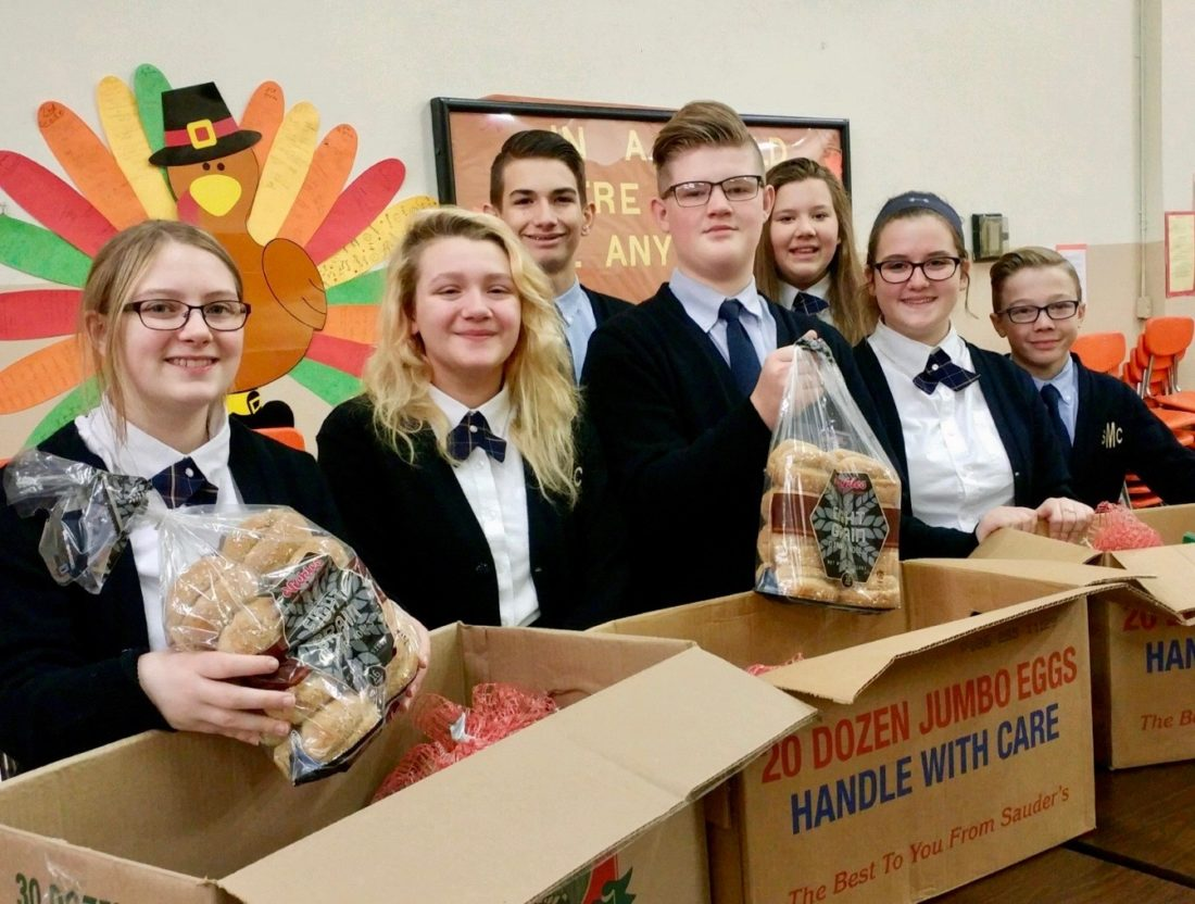 Photo Provided Pictured filling Thanksgiving baskets are St. Mary Central School eighth-graders Brooklyn Lengyel, Alchamy Toth, Caden Horvath, Jacob Powell, Abby Giffin, Yona Helt and Aiden Tarr.