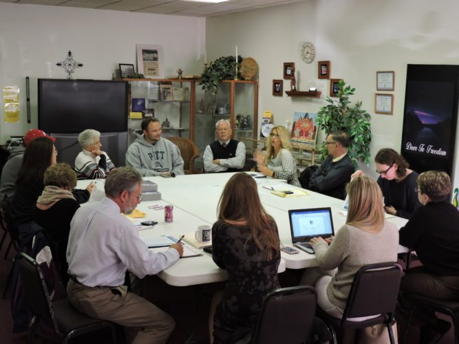 T-L Photo/DYLAN McKENZIE  Members of Martins Ferry Project Forward meet to discuss the upcoming Winterfest celebration in Martins Ferry. The group is working to make sure that a good time will be had by all at the event.