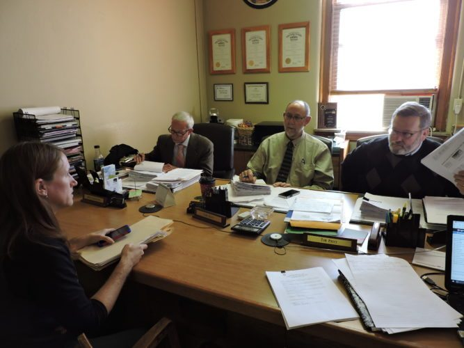 Monroe County Engineer Amy Zwick speaks to Monroe County Commissioners Mick Schumacher, from left, Carl Davis and Tim Price Monday about road use maintenance agreements.    T-L Photo/JANELL HUNTER