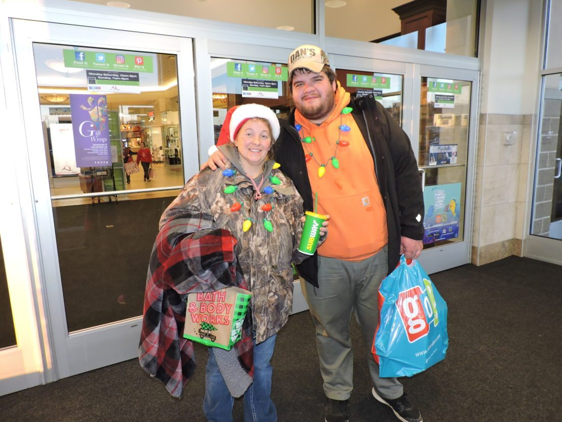TAPPAN LAKE residents Samantha and Christopher get ready to leave the Ohio Valley this morning after a long night of shopping