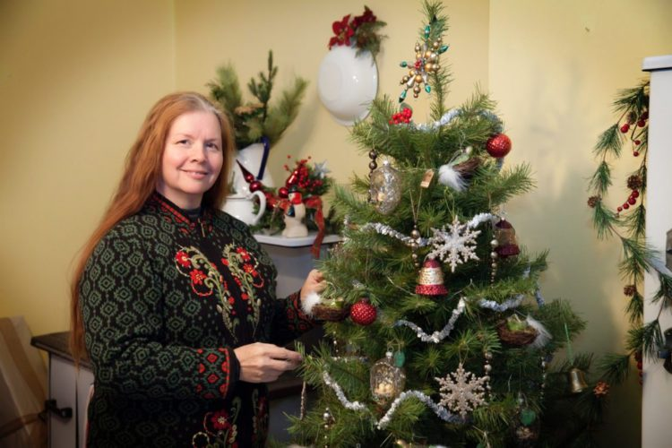 Photo provided ANGELA FEENERTY of Martins Ferry puts the finishing touches on a vintage inspired tree.