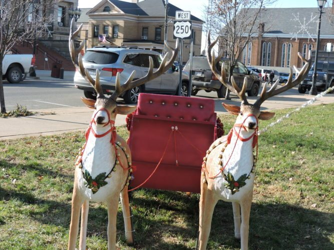T-L Photo/DYLAN McKENZIE  A sleigh and plastic reindeer decorate a lot in Cadiz. The sleigh, along with the large Christmas tree, provide a perfect holiday picture opportunity for villagers.