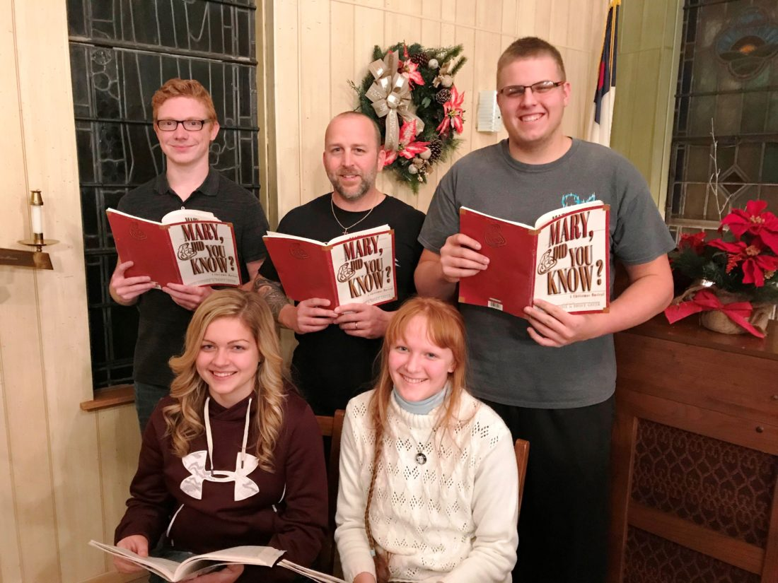 Photo provided ADENA LIONS Club Christmas Cantata choir members, back row, from left, Matt Rector, Drew Case, John Rutan, and front row, Camryn Case and Angelica Kidd.