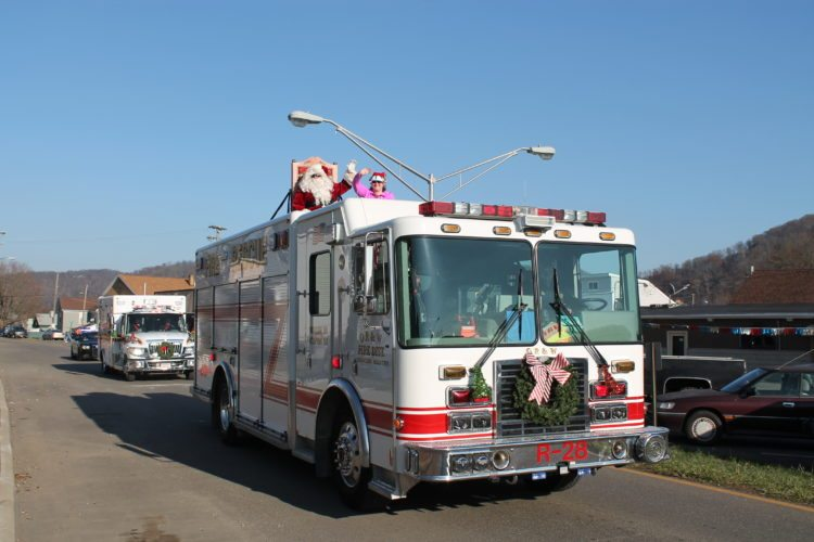 SANTACLAUS makes his triumphant entrance riding atop an OR&WFire District Engine during Sunday's Christmas Parade in Shadyside.  T-LPhoto/KAYLAVANDYNE