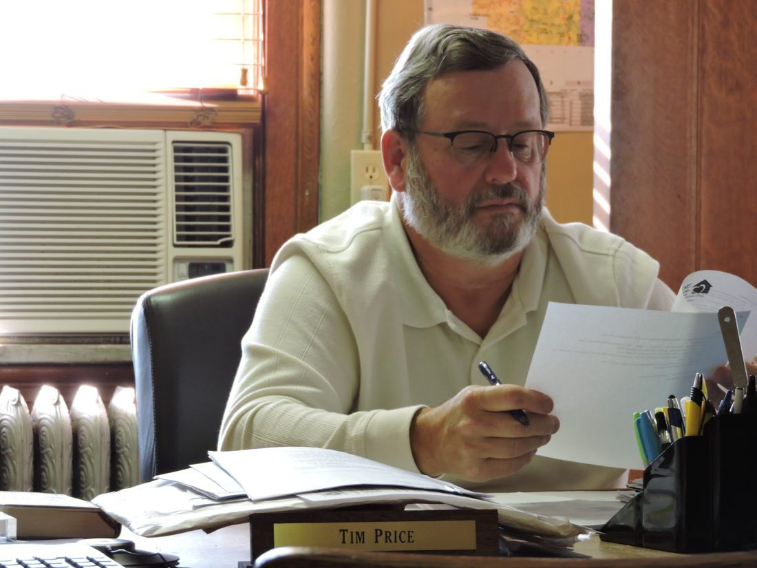 T-L Photo/DYLAN McKENZIE  Monroe County Commissioner Tim Price reads over the agenda for Monday's meeting. The commissioners briefly entered executive session to discuss a labor contract with county Engineer Amy Zwick, emerging with no action  taken.