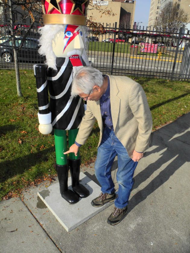 Photo by Warren Scott Jerry Barilla, president of Historic Fort Steuben, points to one of two areas where paint was scraped from the Starman nutcracker when it was taken from the Nutcracker Village on Saturday. Barilla said he is thankful the nutcracker was returned by the two people who face charges of theft in Steubenville Municipal Court in connection with its disappearance.