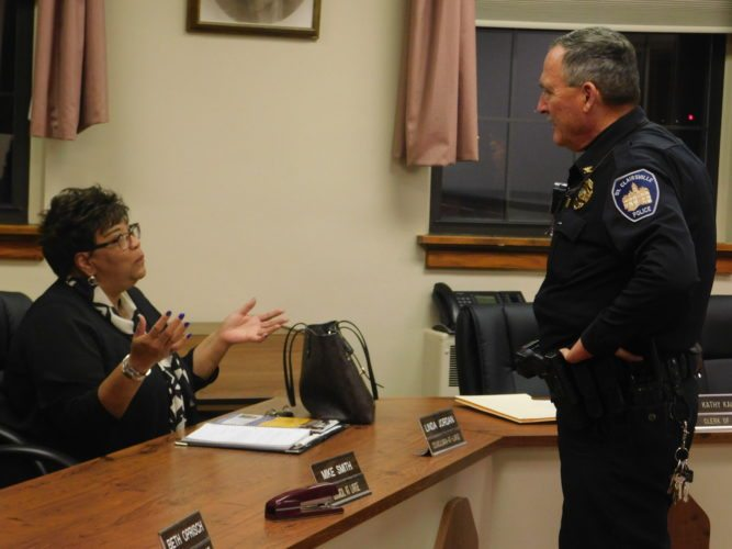 Photo by Robert A. DeFrank St. Clairsville will eliminate its local dispatchers and route calls through the Belmont County 911 system beginning later this month. Police Chief Jeff Henry discusses issues with Councilwoman Linda Jordan prior to the meeting.