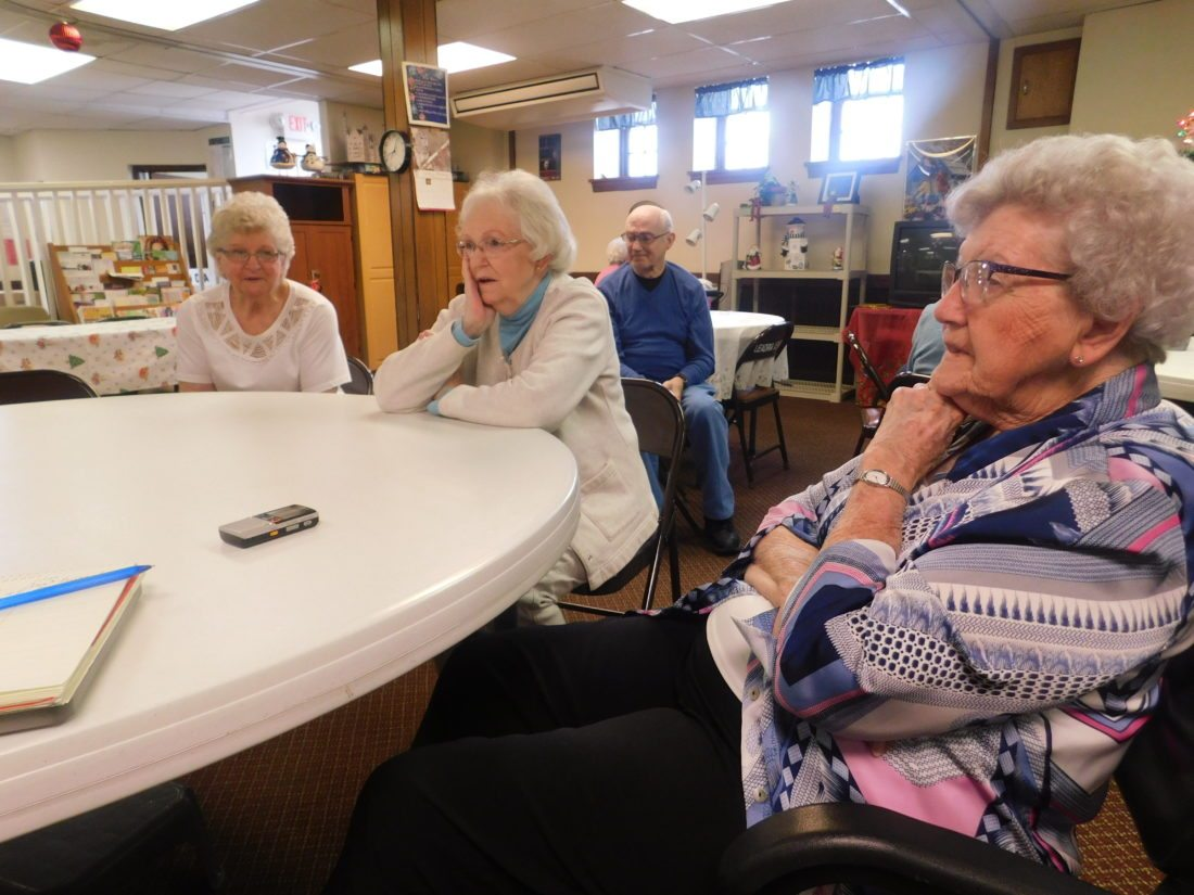 T-L Photo/ ROBERT A. DEFRANK Sharing stories at the St. Clairsville Senior Center about life in America in the wake of the Dec. 7, 1941 attack on Pearl Harbor, from left, are Jenny Miller-Stewart, Rosalie Harris and Jean McMahon. Their memories include rationing, bracing for air raids, and supporting family in the service during World War II.