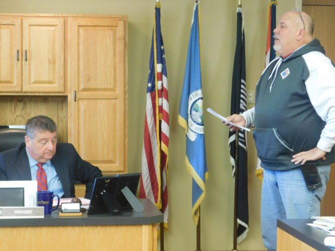 T-L Photo/ROBERT A. DEFRNAK Belmont County EMA Director Dave Ivan relates his department's progress in preparing for emergencies to Belmont County Commissioner Mark Thomas and the rest of the board. He said one piece of valuable equipment is a portable water trailer.