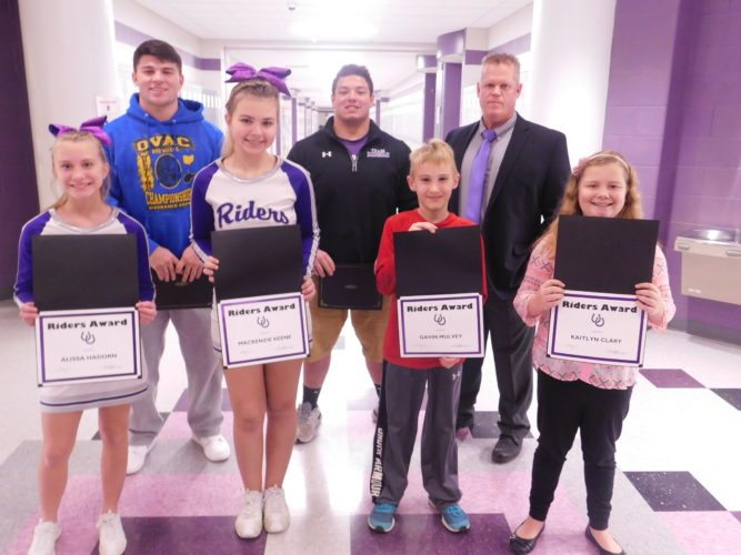 T-L Photo/ ROBERT A. DEFRANK Martins Ferry School District students are honored for various accomplishments during Monday's board of education meeting. In front, from left, are Alissa Hadorn, Mackenzie Keene, Gavin Mulvey and Kaitlyn Clary; and back row, from left, Dalton Hoover, Hunter Bodkin and Superintendent Jim Fogle.