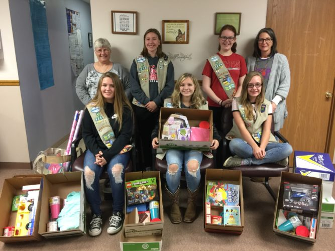 "GIRL SCOUT Troop 3236, led by Becky McLeod and Holly Loy, put together ""Birthday Boxes"" for children who are residents of Peg's House, Tri-County Help Center's Emergency Shelter for domestic violence victims and their children. Standing, from left, are Darlene Bruce, shelter advocate, Emma Sroka, Gwendolyn Kovacs and Cathy Campbell, executive director. Sitting, from left, are Mallary Jeffers, Johnna Sroka and Kaitlyn Grace. Contributing but not pictured was troop member Emily Schmidli."