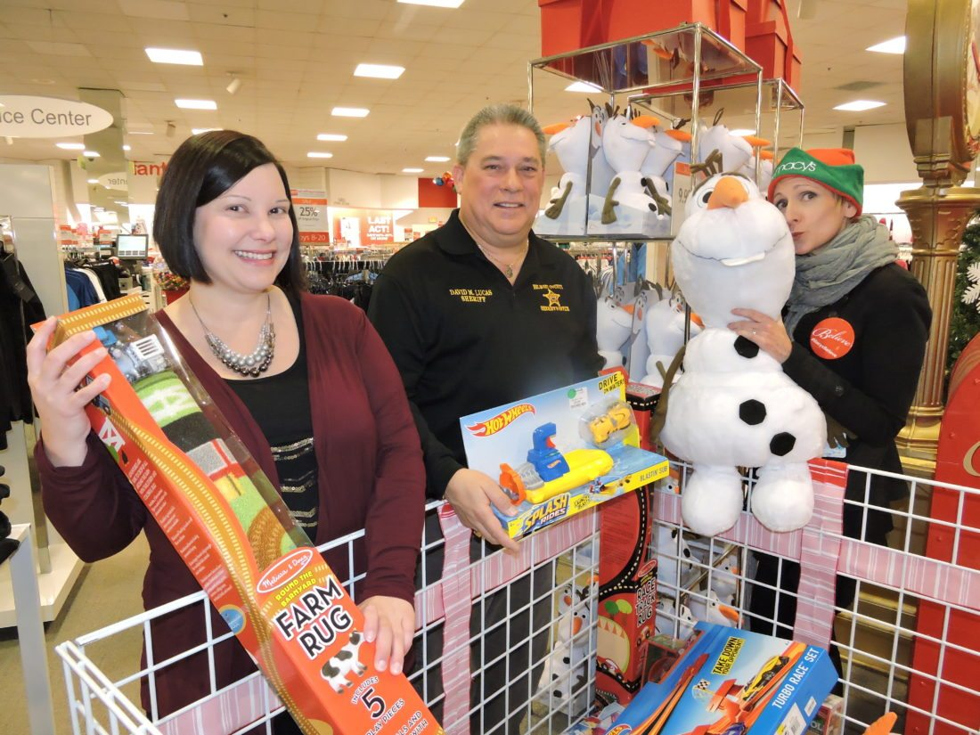 "Photo by Casey Junkins Busy preparing for ""Operation Toy Lift,"" set for 8 a.m. to 4 p.m. Saturday at Macy's at the Ohio Valley Mall, from left, are mall Marketing Director Candi Noble-Greathouse, Belmont County Sheriff Dave Lucas and Macy's store manager Jennifer Prietsch."