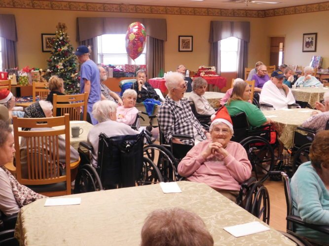 Residents enjoy a Christmas party at the Cumberland Point Nursing Home. This year, the facility received a donation of $600 from the staff of the women's facility at the Ohio Department of Rehabilitation and Correction in Orient.