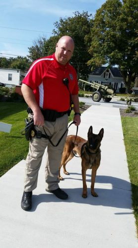 Bethesda Police Chief Eric Smith works with K9 officer Frankie. In addition to serving as chief, Smith is Frankie's handler.