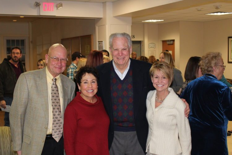 Photo Provided Long time Ohio University Eastern supporters from left, George Carroll, Marylou Goodman, John Goodman and keynote speaker Denise Penz share a moment after the OUE fall graduation ceremony.
