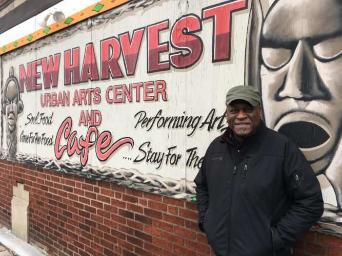 In this Monday, Dec. 18, 2017, photo, Columbus community activist Kwodwo Ababio stands outside his New Harvest Urban Arts Center and Cafe in Columbus, Ohio. The city's soaring homicide rate hit home for Ababio recently when a former foster son was shot and killed. (AP Photo/Andrew Welsh-Huggins)