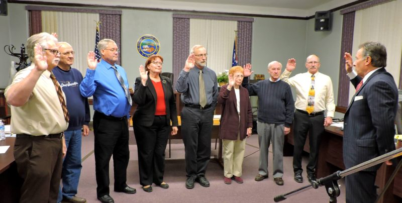 T-L Photos/SHELLEY HANSON BELMONT COUNTY Common Pleas Judge Frank Fregiato, far right, swears in Martins Ferry City Council members for 2018. From left are Thomas Burns, Jack Regis Sr., James Schramm, Council President Kristine Davis, Robert Hunker, Suzanne Armstrong, Rick Rodgers and Bruce Shrodes.