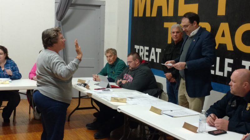 T-L Photo/LENNY WITTENBROOK Beverly Yoe, standing at left, is sworn in as a new member of Belmont Village Council. She was appointed to a vacant seat Thursday. Village Solicitor T.J. Stewart administers the oath of office while other members of council look on.