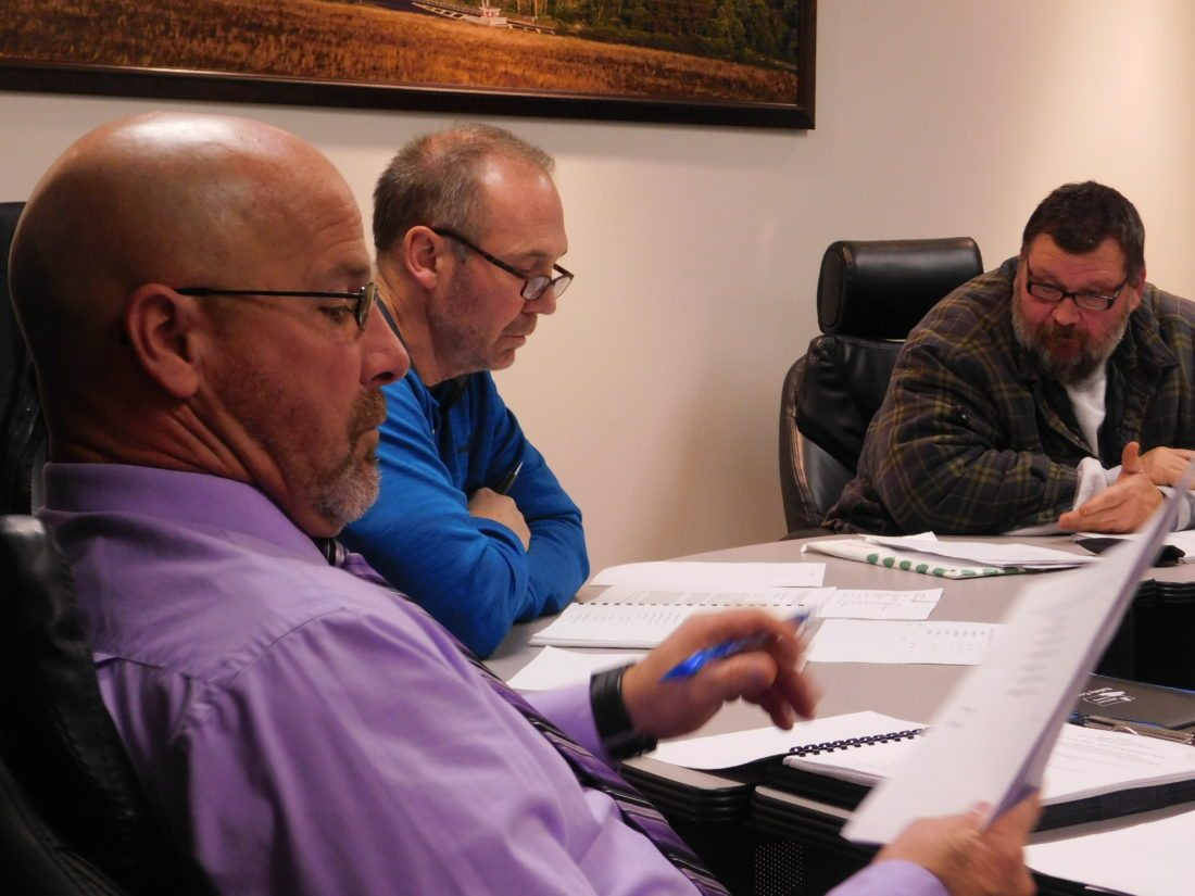 T-L Photo/ ROBERT A. DEFRANK New Martins Ferry City Schools Board of Education member Bill Suto, from left, reviews business with member Scott Ballint and board President Nick Stankovick during a Monday meeting.