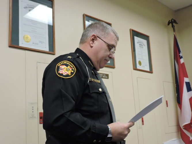 T-L Photo/DYLAN McKENZIE  Harrsion County Sheriff Ron Myers reads off his year in review report at Wednesday's meeting. Myers reported that the Harrison County Sheriff's Department spent a total of $562,894 in jail keep for the year.