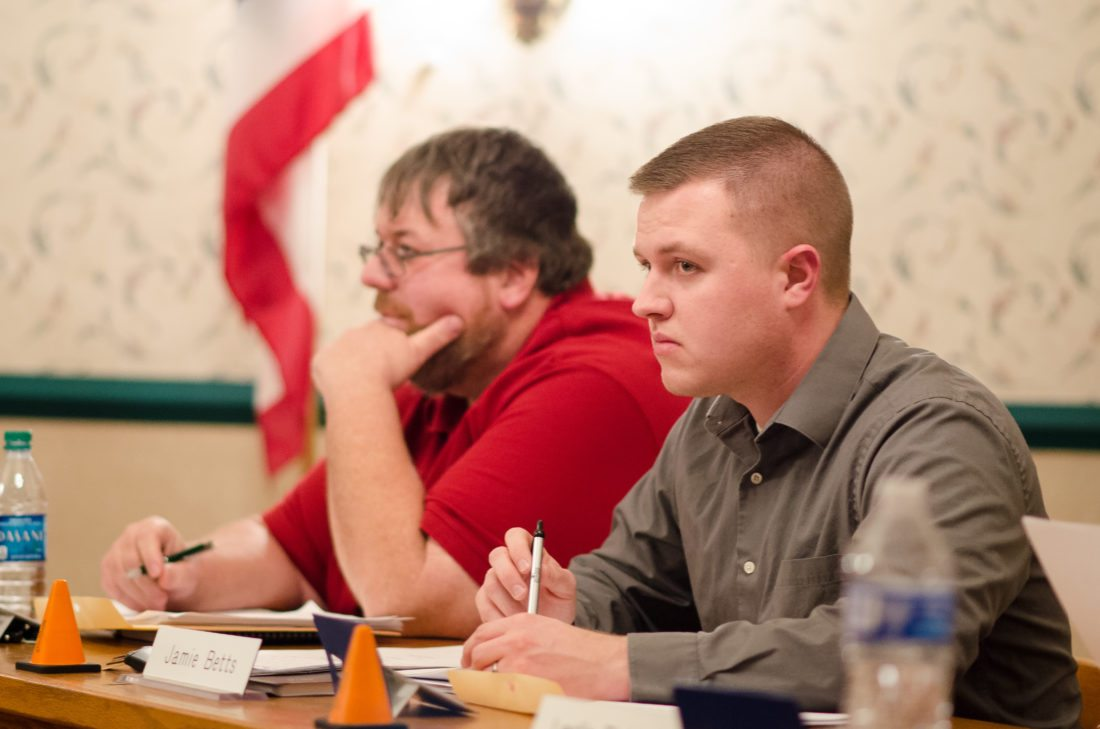 T-L Photo/MIRANDA SEBROSKI New Barnesville Village Council member Jamie Betts, right, participates in his first meeting of 2018. Seated next to him is Brad Hudson, who was named president of council.