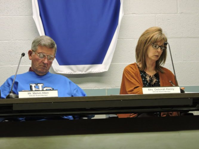 T-L Photo/DYLAN McKENZIE  Harrison Hills City School District members Melvin Allen and Deborah Kenny look over agendas at Thursday's organizational meeting. Kenny and Allen were voted in as board president and vice president respectively.