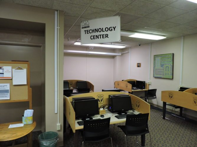 T-L Photo/ROBERT A. DEFRANK Eric Jiga, new technology trainer at the St. Clairsville Public Library, will be answering questions and providing guidance to visitors.