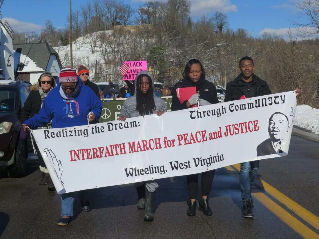 Photo/Joselyn King Students representing Wheeling Jesuit University's Black Student Union march down Wheeling Hill during the Interfaith March For Peace and Justice Sunday. The event was one of many set to commemorate Martin Luther King Jr. weekend by WJU and faith-based community partners.