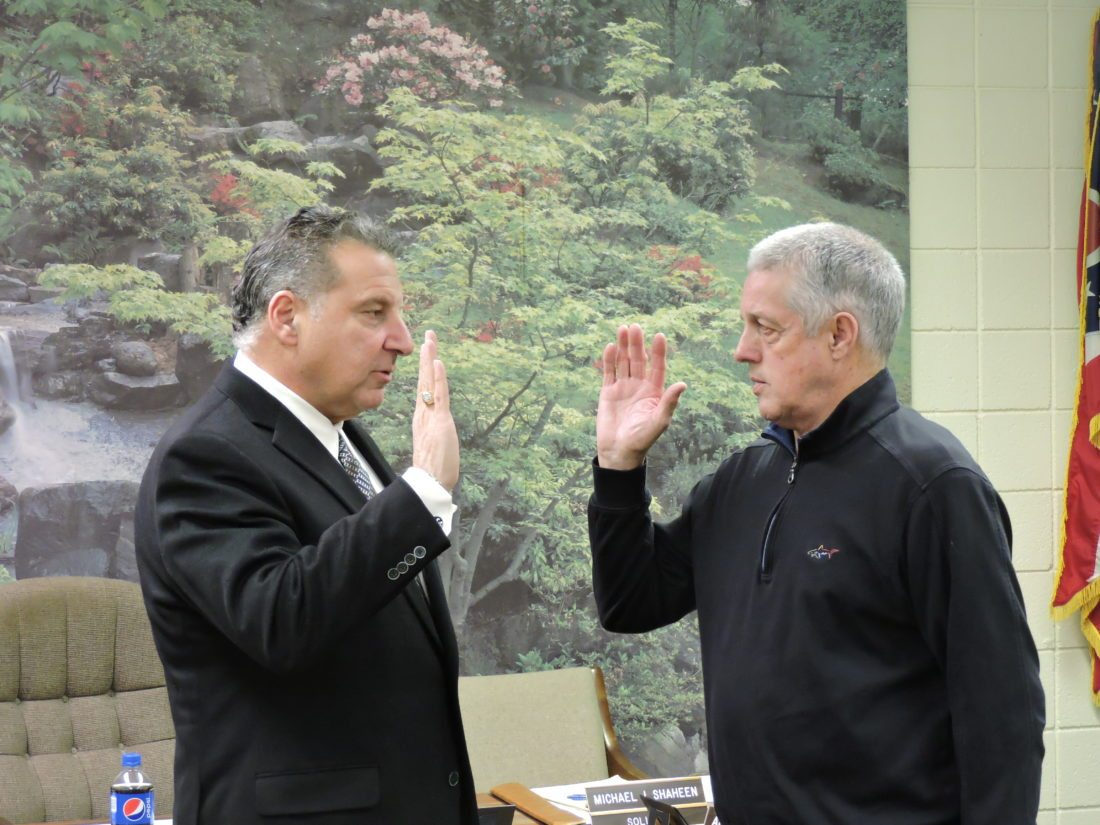 T-L Photo/DYLAN McKENZIE  Bridgeport Solicitor Michael Shaheen swears in Joe Lyle as the newest member of village council. Lyle was appointed at Tuesday's meeting.