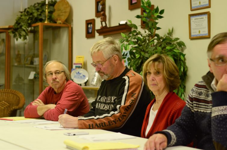 T-L Photo/MIRANDA SEBROSKI PROJECT FORWARD member Jim Schramm, center, looks over project ideas for the city. Seated beside him is Andy Sutak, left, and Linda Brown.   PROJECTFORWARD 2 T-L Photo/MIRANDA SEBROSKI THE REV. William Webster, left, gets elected president of Project Forward with Mayor Robert Krajnyak seated beside him.   PROJECTFORWARD 3 T-L Photo/MIRANDA SEBROSKI PROJECT FORWARD member Anthony Orsini looks over the Project Forward agenda.   Project Forward plans Strawberry Festival for June
