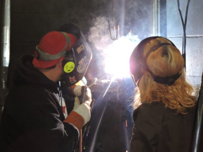 West Virginia Northern Community College Welding Program Director Matthew Pallisco and welding instructor Brandy Killeen display their skills on Friday. By fall semester this year, they will move into a new $4.7 million Industrial Technology Center in East Wheeling.   Photo by  Casey Junkins