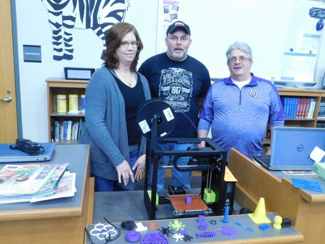 Stacey Bliss, Martins Ferry High School librarian and adviser to the technology club, joins Greg Steele and Bruce Hotlotz, assistant director and director of the district's STEM academy, respectively. THe three work together to provide additional opportunities for students.       T-L Photos/ ROBERT  DEFRANK