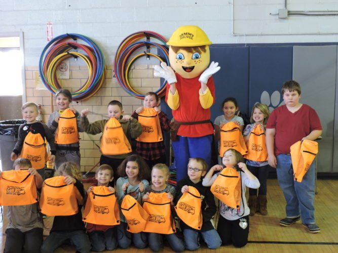 T-L Photo/DYLAN McKENZIE/ Second-graders at Buckeye North Elementary School pose with âSammy Shovel,ã a mascot from the Ohio Utility Protection Service, on Monday. Students were treated to a fun presentation on the importance of calling before they or their parents dig in the yard.