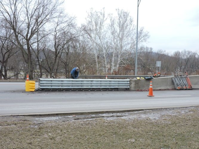 T-L Photo/DYLAN McKENZIE  Construction crews spent time Tuesday installing a new end barrier on Ohio 7 near Bridgeport. The center barrier was damaged after an accident that took place in early December.