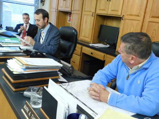 T-L Photo/ ROBERT A. DEFRANK BELMONT COUNTY Commissioners Josh Meyer at the left, J.P. Dutton at the center and Mark Thomas on the right renew a contract to house Belmont County's excess inmates at Jefferson County's jail.