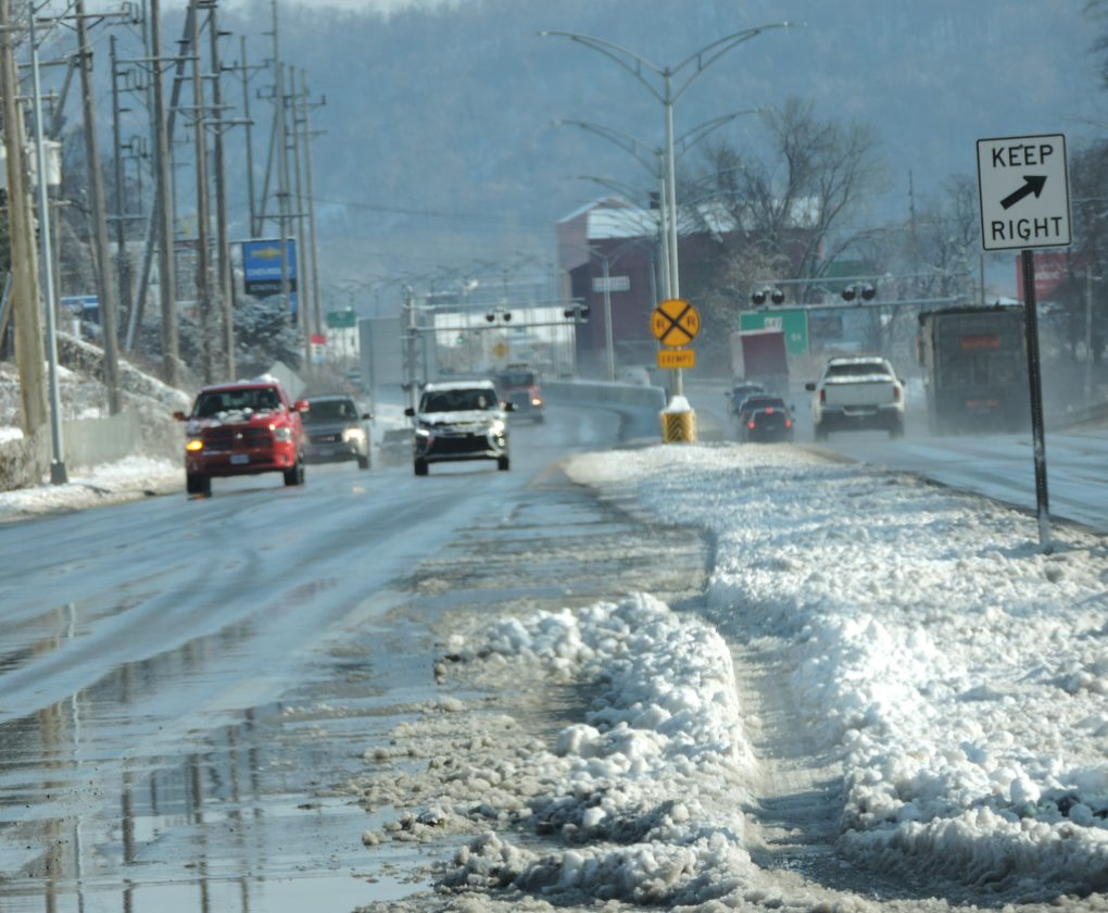 T-L Photo/SHELLEY HANSON/ Motorists make their way on a wet, slushy Ohio 7 in Martins Ferry this morning. Ohio Valley residents awoke to 4 inches or more of snow this morning.
