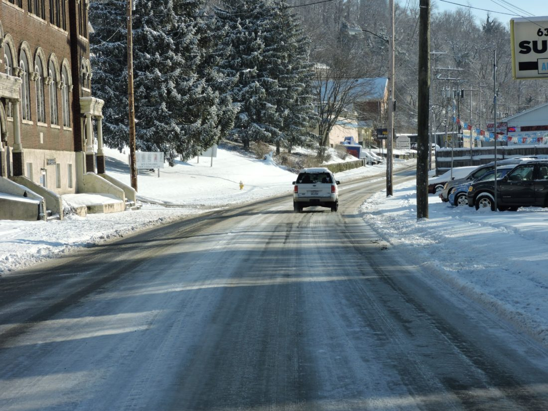 T-L Photo/SHELLEY HANSON A MOTORIST carefully makes their way along a snowy U.S. 40 in Bridgeport on Monday morning.