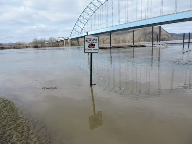 T-L Photo/MIRANDA SEBROSKI The riverfront area in Moundsville is submerged in water from flooding Sunday. Residents near the area will begin cleaning up and dealing with damage today after the water recedes.