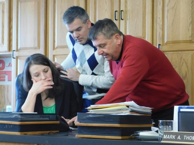 T-L Photo/ROBERT A. DEFRANK Belmont County Land Bank board members Kathy Kelich, from left, Josh Meyer and Mark Thomas review potential properties for the bank to acquire. Representatives from Brookside and Powhatan Point inquired about the possibility of the land bank expanding operations into their areas.