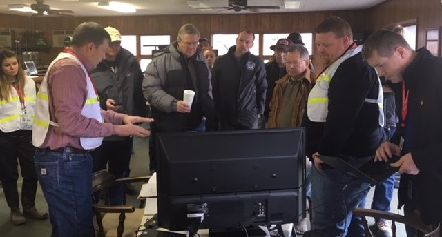 Photo Provided XTO Energy's Brian Teller briefs the directors of the Ohio Department of Natural Resources and Ohio Environmental Protection Agency on the well control incident near Powhatan Point on Saturday.